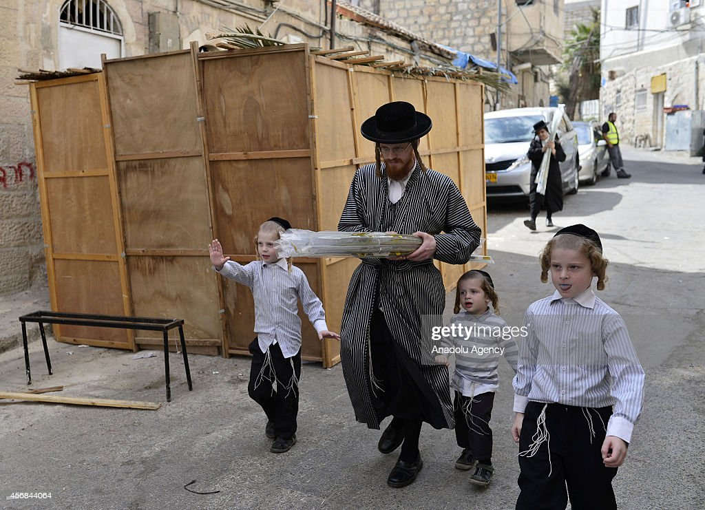 Orthodox jews are seen as they prepare for a week-long Sukkot which commemorates the forty-year period during which the children of Israel were wandering in the desert, living in temporary shelters in Jerusalem, Israel on October 8, 2014.