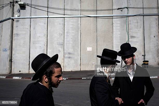 Orthodox Jews are seen standing in front of separation walls protecting the holy site of Rachels Tomb on January 18, 2017 in Bethlehem, West Bank. 70...