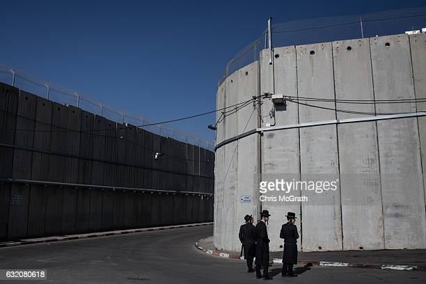 Orthodox Jews are seen standing in front of separation walls protecting the holy site of Rachels Tomb on January 18 2017 in Bethlehem West Bank 70...