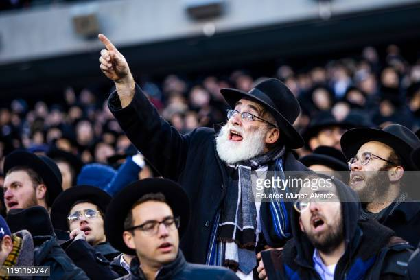 Orthodox Jews attend during the 13th Siyum HaShas, a celebration marking the completion of the Daf Yomi, at the MetLife Stadium on January 1, 2020 in...