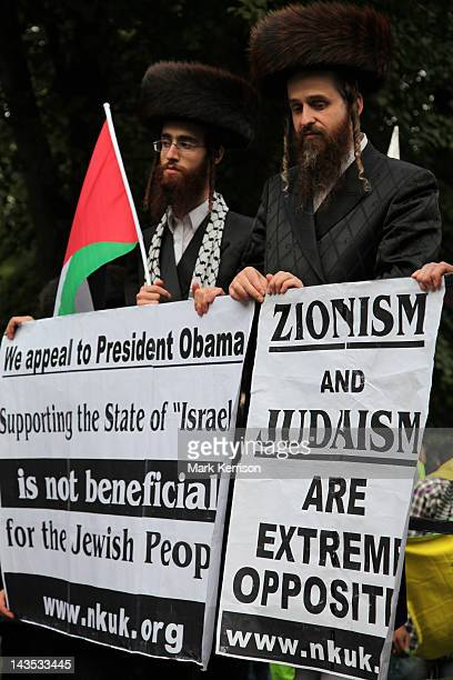 Orthodox Jews belonging to Neturei Karta hold placards outside the US embassy at the annual al-Quds Day rally in London.