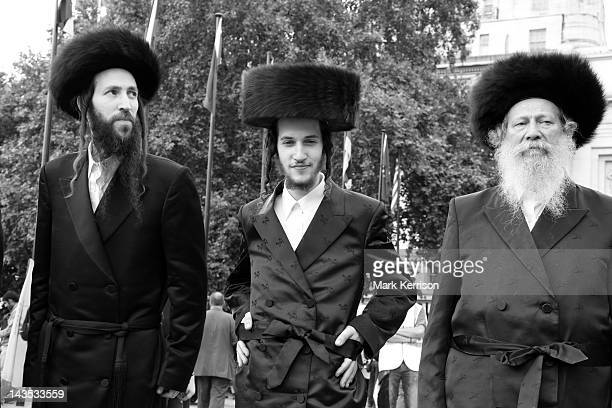 Orthodox Jews belonging to Neturei Karta pose for pictures before the annual al-Quds Day march in Central London on 4th September 2010.