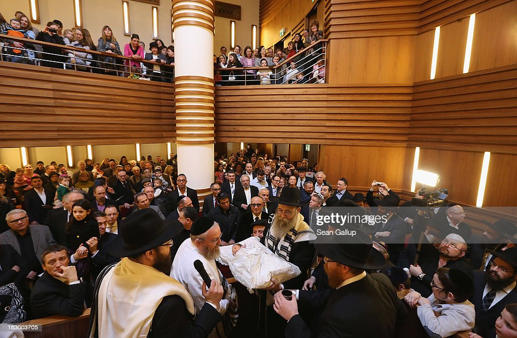 Orthodox Jews conclude the circumcision ceremony of baby infant Mendl Teichtal at the Chabad Lubawitsch Orthodox Jewish synagogue on March 3, 2013 in Berlin, Germany. Germany's parliament, the Bundestag, passed a law affirming the legality of circumcision in December after a Cologne court called the practice into question in May of 2012, a ruling that sparked outrage among Germany's Jewish and Muslim population.
