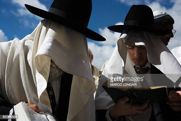 Orthodox Jews cover their heads with prayer shawls as they take part in the Blessing of the Priests ceremony or 'Birkat Cohanim' at the Western Wall...