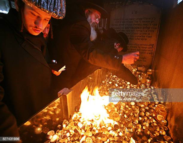 Orthodox Jews from Stamford Hill light candles at the tomb of Rabbi Shulem Moshkovitz The Shotzer Rebbe who is buried in the Adath Yisroel cemetery...