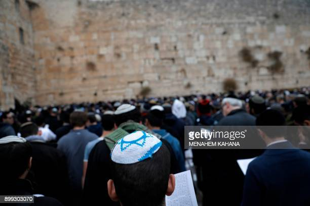 Orthodox Jews gather at the Western Wall in the Old City of Jerusalem on December 28 2017 to pray for rain The mass prayer was initiated in response...