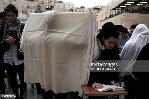 Orthodox Jews gather at the Western Wall in the Old City of Jerusalem on December 28 to pray for rain The mass prayer was initiated in response to...