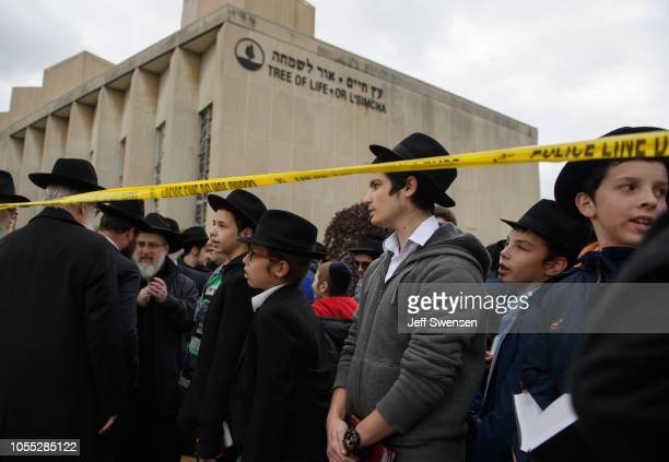 Orthodox Jews gather to hold a prayer session Monday afternoon at the site of the mass shooting that killed 11 people and wounded 6 at the Tree Of...