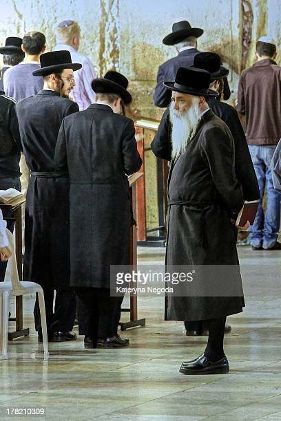 Orthodox Jews in Shabbat praying by Wailing Wall . The Western Wall, Wailing Wall or Kotel is located in the Old City of Jerusalem at the foot of the...