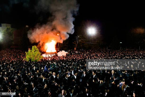 Orthodox Jews of the Satmar Hasidim gather before a bonfire in the village of Kiryas Joel New York May 14 during celebrations for the Jewish holiday...