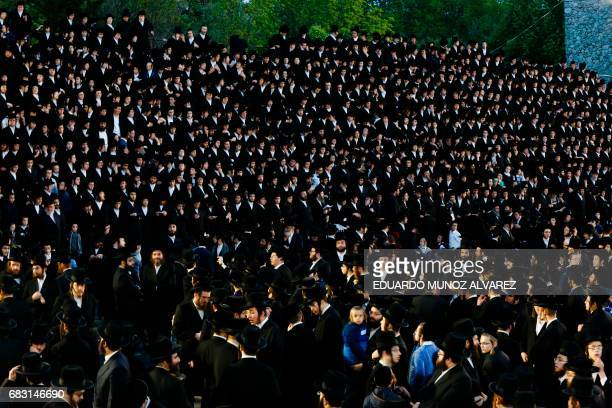 Orthodox Jews of the Satmar Hasidim gather in the village of Kiryas Joel New York May 14 during celebrations for the Jewish holiday of Lag BaOmer...