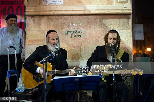 orthodox jews playing secular tunes in jerusalem - jewish people stock pictures, royalty-free photos & images