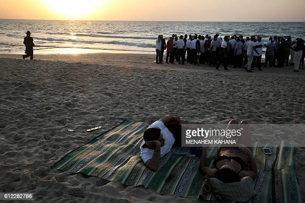 TOPSHOT Orthodox Jews pray in front of the Mediterranean Sea on October 3 2016 in the Israeli city of Ashdod south of Tel Aviv during the 'Tashlich'...