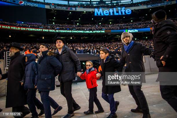 Orthodox Jews sing and dance during the 13th Siyum HaShas a celebration marking the completion of the Daf Yomi at the MetLife Stadium on January 1...