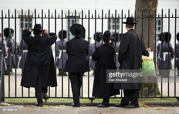 Orthodox Jews watch the Grenadier Guards participating in ceremonial duties at Wellington Barracks on November 5 2009 in London England Three...