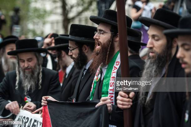 Orthodox Jews who oppose Israel attend as thousands of people attend a protest and block Whitehall to demonstrate against the Israeli bombing of Gaza...