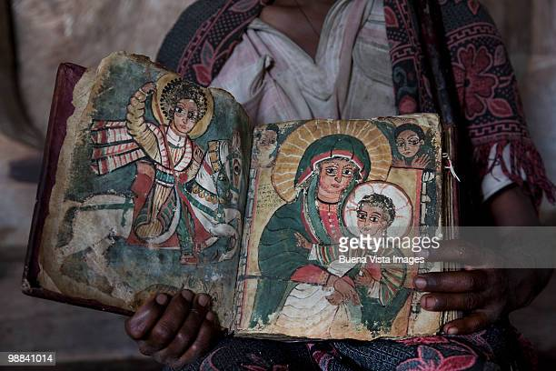 orthodox priest with old bible - orthodox church stock pictures, royalty-free photos & images