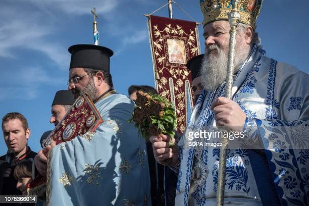 Orthodox priests seen chanting holy words during the annual Epiphany Day and the blessing of the waters celebration in the center of Chania Greece