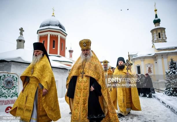 Orthodox priests walk during a religious procession celebrating Saint Peter of Kiev, Metropolitan of Kiev and Moscow, at the Vissoko Petrovsky...