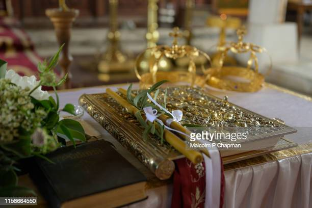 orthodox wedding - crowns and candles, sozopol, burgas, bulgaria - ceremony stock pictures, royalty-free photos & images