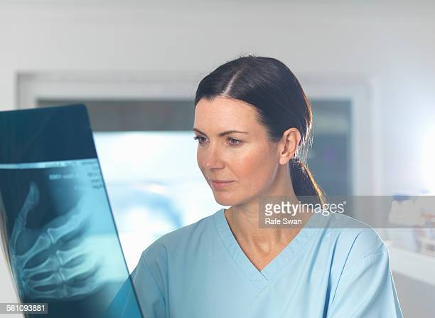 Orthopaedic consultant viewing x-ray of hand
