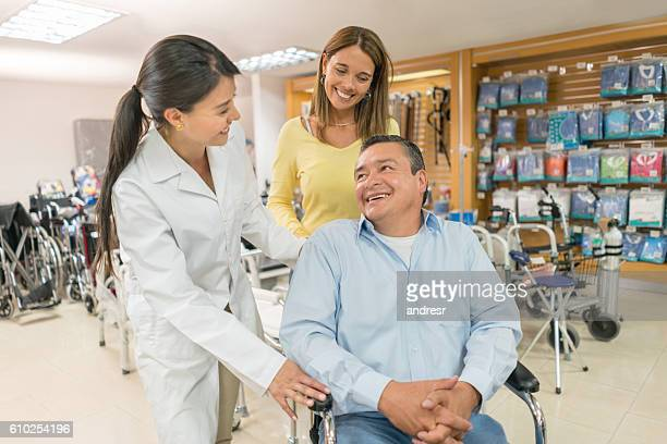 orthopedist selling wheelchairs at a health store - medical supplies stock pictures, royalty-free photos & images