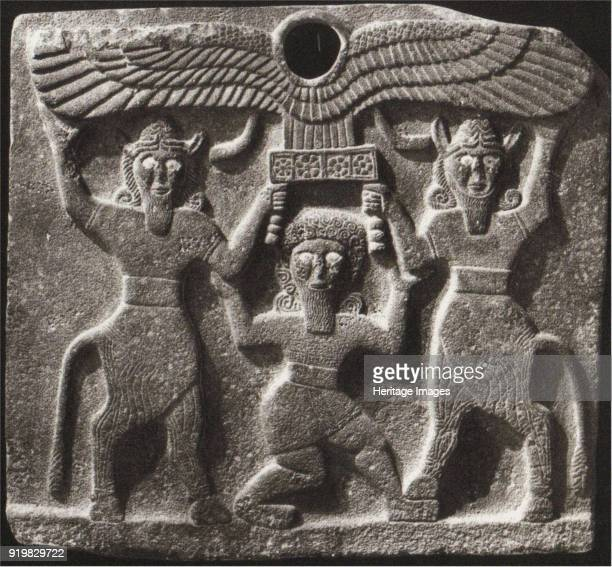 Orthostates depicting Gilgamesh between two minotaur demigods holding up the sun disc From Tell Halaf Syria 9th century BC Found in the collection of...