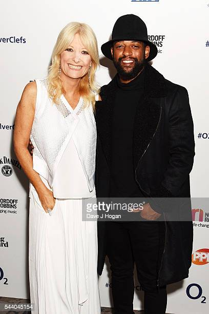 Ortise Williams and Gaby Roslin pose for a photo during the Nordoff Robbins O2 Silver Clef Awards on July 1 2016 in London United Kingdom