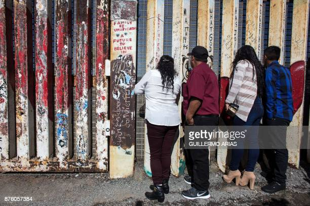 Ortiz family members living on different sides of the USMexico border wait before been briefly reunited during the Opening the Door of Hope event at...