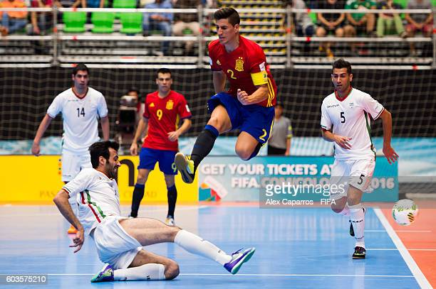 Ortiz of Spain jumps over the tackle of Ahmad Esmaeilpour of Iran during the FIFA Futsal World Cup Group F match between Iran and Spain at Coliseo...