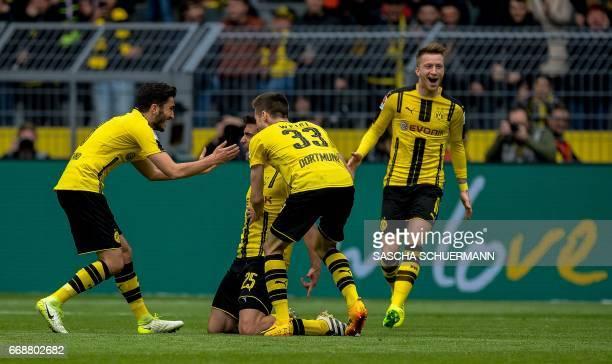 ortmund's Greek defender Sokratis Papastathopoulos celebrates scoring the 21 with his teammates during the German First division Bundesliga football...