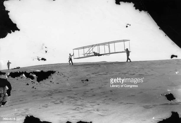 Orville and Wilbur Wright testing their No 3 glider at Kill Devil Hills, near Kitty Hawk, North Carolina.