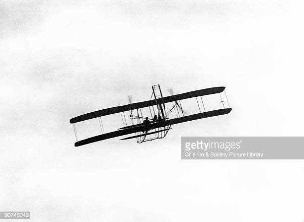 Orville Wright at the controls of the aircraft carrying the first military air passenger at Fort Myer Virginia Orville Wright and his brother Wilbur...