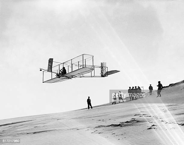 Orville Wright flies a glider over Kill Devil Hills