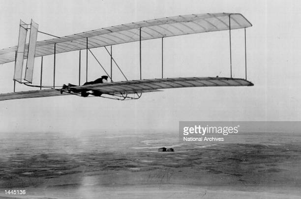 Orville Wright flies a glider with a movable double rear vertical rudder in Kitty Hawk, NC in 1903.