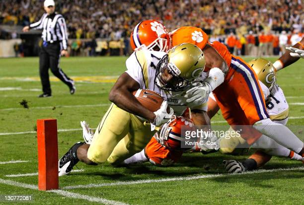 Orwin Smith of the Georgia Tech Yellow Jackets scores a touchdown against Xavier Brewer of the Clemson Tigers at Bobby Dodd Stadium on October 29...
