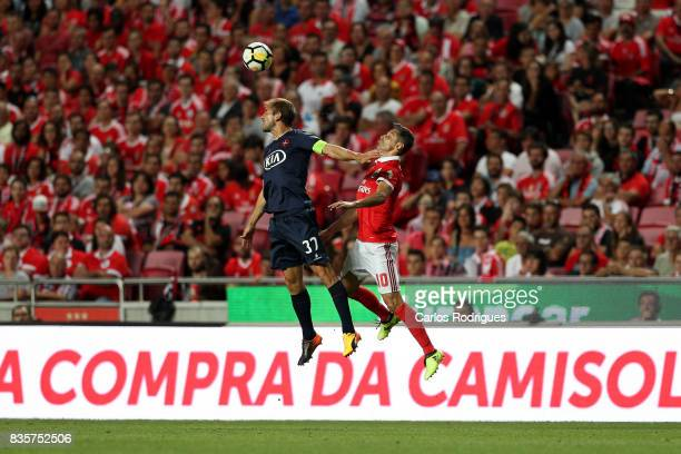 Os Belenenses defender Goncalo Silva from Portugal vies with Benfica's forward Jonas from Brasil during the match between SL Benfica and CF...