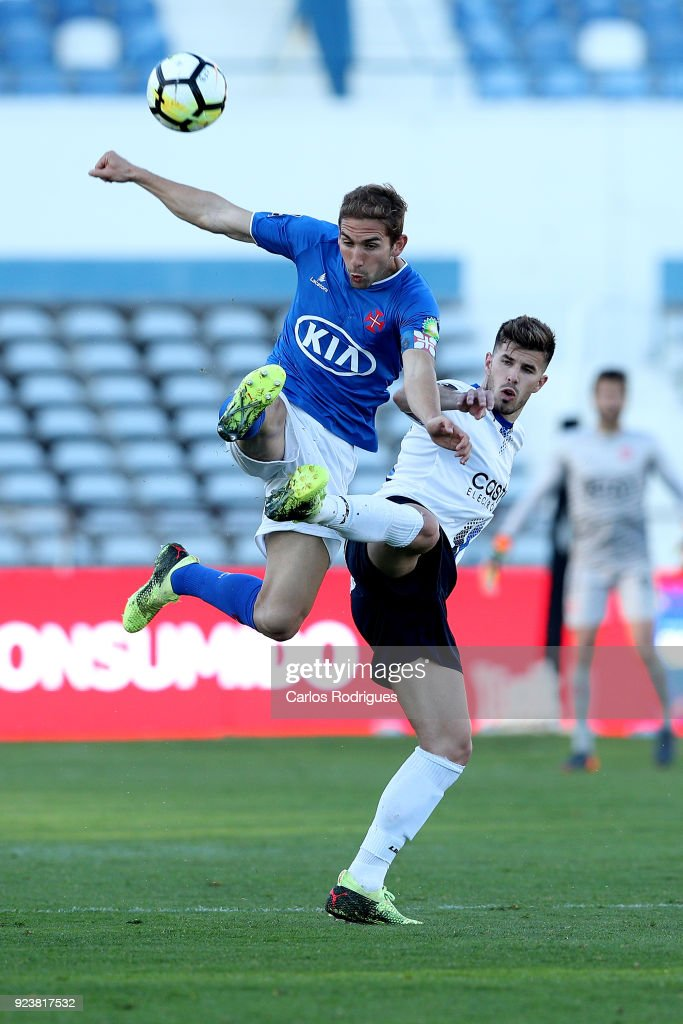 CF Os Belenenses defender Goncalo Silva from Portugal (L) vies with Feirense forward Joao Silva from Portugal (R) for the ball possession during the Primeira Liga match between CF Os Belenenses and CD Feirense at Estadio do Restelo on February 24, 2017 in Lisbon, Portugal.