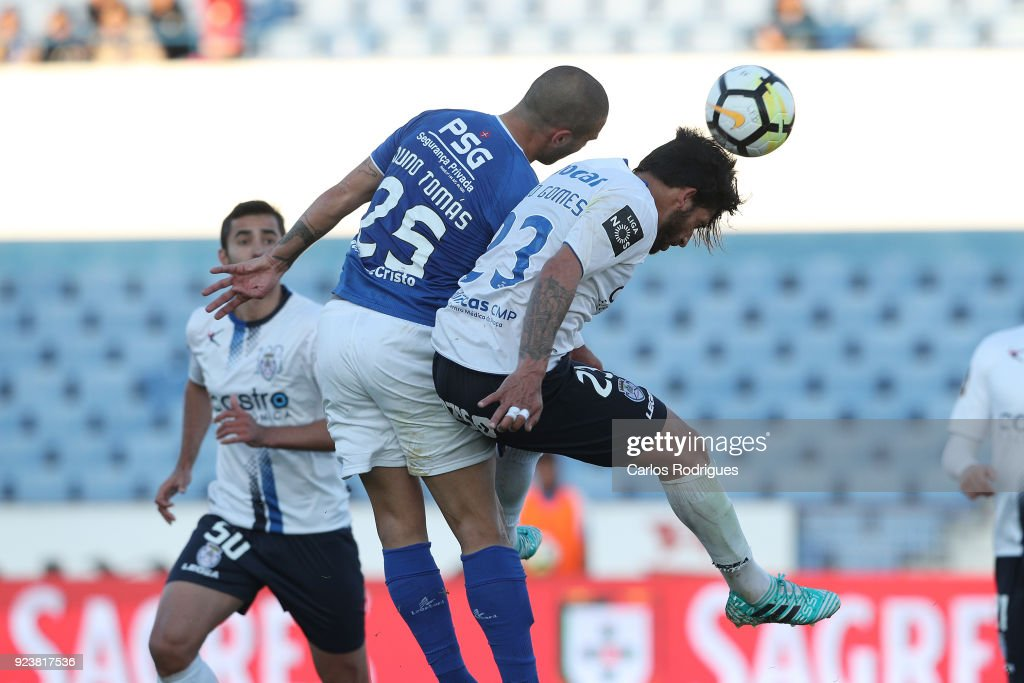 CF Os Belenenses defender Nuno Tomas from Portugal (L) vies with Feirense defender Tiago Gomes from Portugal (R) for the ball possession during the Primeira Liga match between CF Os Belenenses and CD Feirense at Estadio do Restelo on February 24, 2017 in Lisbon, Portugal.
