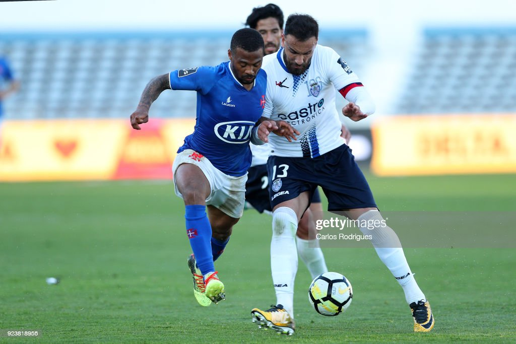 CF Os Belenenses forward Fredy from Angola (L) vies with Feirense defender Luis Rocha from Portugal (R) for the ball possession during the Primeira Liga match between CF Os Belenenses and CD Feirense at Estadio do Restelo on February 24, 2017 in Lisbon, Portugal.
