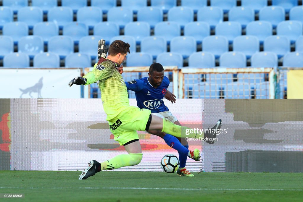 CF Os Belenenses forward Fredy from Angola (B) vies with Feirense goalkeeper Caio Secco from Brasil (F) for the ball possession during the Primeira Liga match between CF Os Belenenses and CD Feirense at Estadio do Restelo on February 24, 2017 in Lisbon, Portugal.