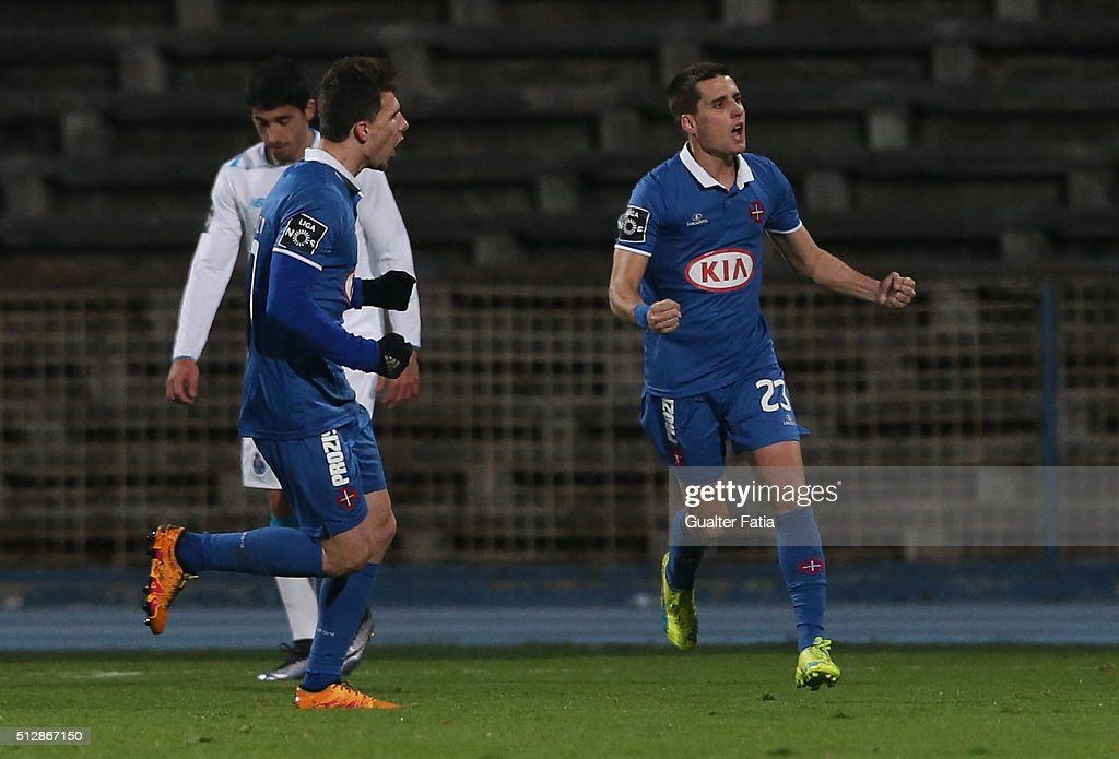 Os Belenenses' forward from Spain Juanto Ortuno (R) celebrates after scoring a goal during the Primeira Liga match between Os Belenenses and FC Porto at Estadio do Restelo on February 28, 2016 in Lisbon, Portugal.