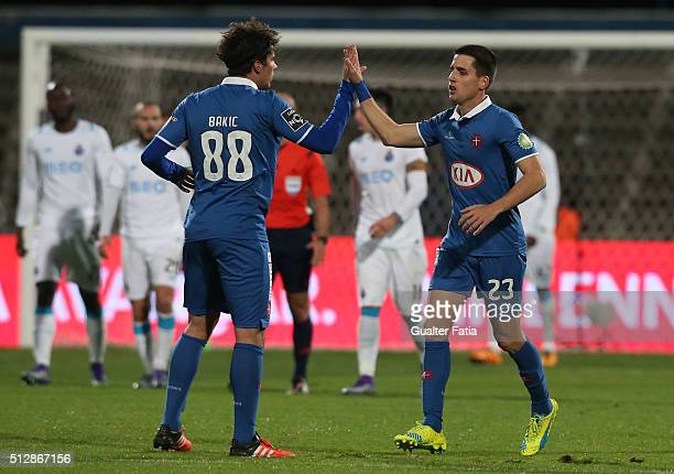 Os Belenenses' forward from Spain Juanto Ortuno celebrates with teammates after scoring a goal during the Primeira Liga match between Os Belenenses...