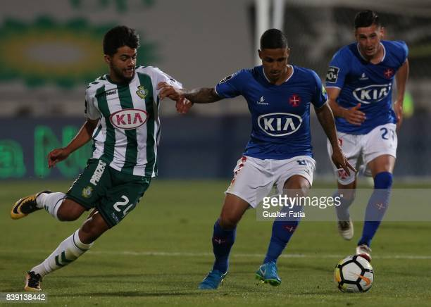 Os Belenenses forward Roni from Brazil with Vitoria Setubal forward Joao Amaral from Portugal in action during the Primeira Liga match between CF Os...