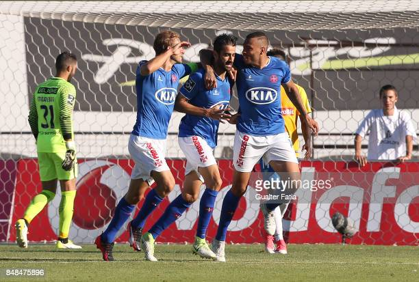 Os Belenenses forward Tiago Caeiro from Portugal celebrates with teammates after scoring a goal during the Primeira Liga match between CF Os...