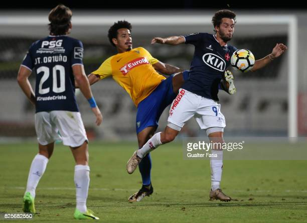 Os Belenenses midfielder Filipe Chaby from Portugal with GD Estoril Praia midfielder Lucas Evangelista from Brazil in action during the PreSeason...