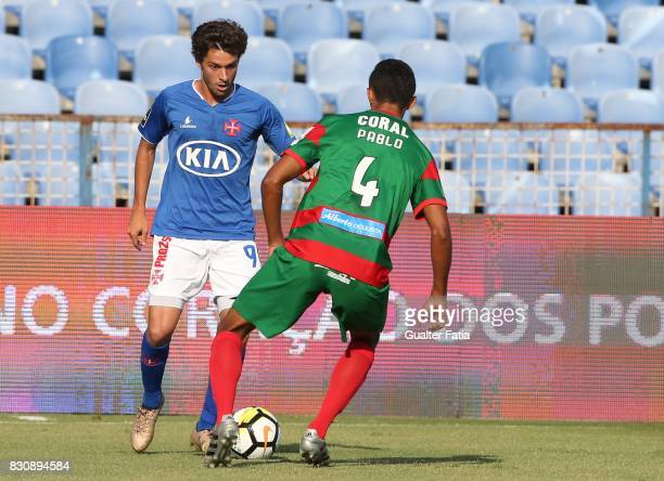 Os Belenenses midfielder Filipe Chaby from Portugal with CS Maritimo defender Pablo Santos from Brazil in action during the Primeira Liga match...