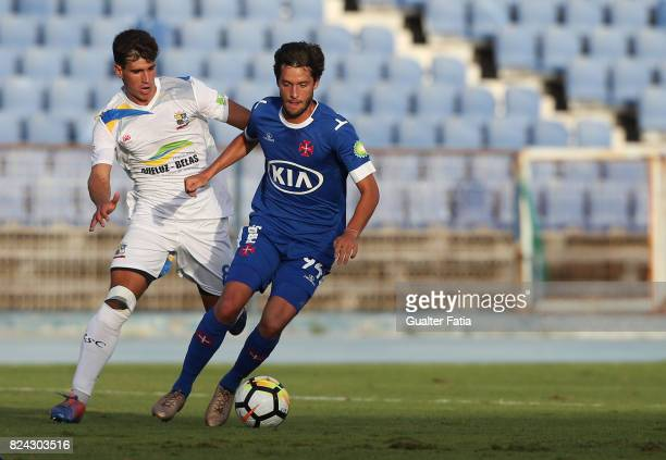 Os Belenenses midfielder Filipe Chaby from Portugal with Real SC midfielder Tiago Morgado from Portugal in action during the League Cup match between...