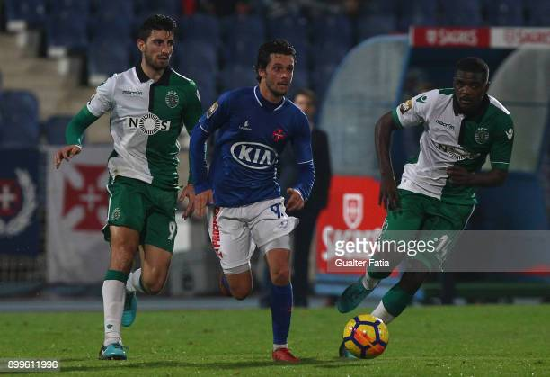 Os Belenenses midfielder Filipe Chaby from Portugal with Sporting CP defender Cristiano Piccini from Italy and Sporting CP midfielder William...