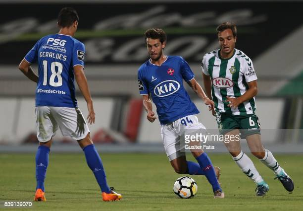 Os Belenenses midfielder Filipe Chaby from Portugal with Vitoria Setubal midfielder Tomas Podstawski from Portugal in action during the Primeira Liga...